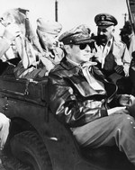 Douglas MacArthur on a jeep tour of the port facilities at Inchon, South Korea, 16 Sep 1950. Behind him are Marine Major General Oliver P Smith and Navy Vice Admiral Arthur D Struble.