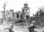 US Marines aiming at a church suspected of being a Japanese position, Okinawa, Japan, 1945