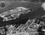 Aerial view of Ford Island in Pearl Harbor, Hawaii, 7 Jan 1941. Note the Pearl Harbor Naval Operating Base in the foreground and the carrier USS Lexington (Lexington-class) on the far side of Ford Island.