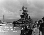 Battleship USS Nevada entering Pearl Harbor's Drydock No. 2, 18 Feb 1942. Photo 1 of 2.