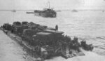 Rhino ferry F94 moving away from HMS LST-320 heading for the Normandy beachhead along the port side of HMS LST-412, France, Jun 1944