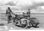 German military police K800 motorcycle in the Soviet Union, Jul-Aug 1941; note sign warning of hostile partisan fighters