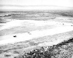 Aerial view of a glider training airstrip in Texas, 1943. Visible are C-47 Skytrain tow planes with Waco CG-4A gliders. Note the CG-4A in tow taking off.