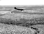 C-47 Skytrain practicing parachute supply drops at a training area in Texas, 1943.