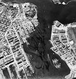 Aerial view of shipping in the Pearl Harbor Navy Yard dry docks, 12 Dec 1943. Note USS Lexington (Essex-class) in the new Drydock No. 4 at the top of the photo.