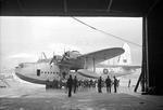 A war weary Sunderland III flying boat of Royal Australian Air Force No. 10 Squadron being hauled out of the water for an overhaul at Mount Batten Seaplane Base, Devon, England, United Kingdom, Jan 1943