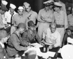 Japanese RAdm Shigematsu Sakaibara signing the surrender of Wake Island to US Marine BGen Lawson Sanderson aboard USS Levy, 4 Sep 1945. Care was made to ensure the Japanese surrendered Wake to the Marines.