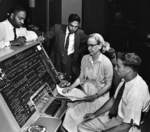 Donald Cropper, K. C. Krishnan, Grace Hopper, and Norman Rothberg working with a UNIVAC computer, circa 1960