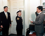 Secretary of the Navy John Lehman promoting Grace Hopper to the rank of commodore, White House, Washington DC, United States, 15 Dec 1983; observed by US President Ronald Reagan