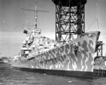 Cruiser Juneau coming alongside a pier at the New York Navy Yard in Feb 1942 prior to her commissioning.