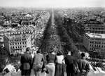 United States Army personnel on top of l'Arc de Triomphe in Paris, France watching the celebration in the streets over the war in Europe coming to an end, 8 May 1945.