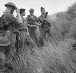 Instructor showing men of UK Royal Welch Fusiliers how to fire a 2-inch mortar from the hip, Northern Ireland, United Kingdom, 21 Aug 1942