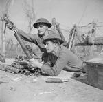 2-inch mortar team of 2nd London Irish Rifles firing mortar rounds at German positions on Senio River, Italy, 22 Mar 1945