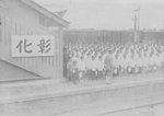 Students gathering to wave to Crown Prince Hirohito, who would be passing by aboard a train, Shoka Station, Taiwan, 20 Apr 1923