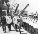 Benito Mussolini reviewing a warship, Taranto, Italy, 21 Jun 1942; note Angelo Iachino and Arturo Riccardi behind Mussolini, and sailor Antonio Angelo Caria sixth from right who released this photo into public domain