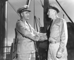 Captain Ralph Chrstie congratulating Lieutenant Commander John Moore of USS S-44 on the sinking of Kako, Brisbane, Australia, 23 Aug 1942