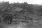 Members of US 5332nd Brigade (Provisional) at a village between Ningpawn and Pranglui, Burma, 3 Jan 1945