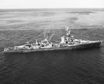 "USS Portland in the Panama area while en route from the Pacific combat area to the US east coast, 12 Oct 1945. Note men crowded on her decks, and the long ""homeward bound"" pennant flying from her mainmast."