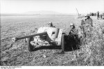 Troops of PK XI. Fliegerkorps with a 5 cm PaK 38 anti-tank gun, Tunisia, 1943
