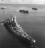 USS Missouri moored in Apra Harbor, Guam, Mariana Islands, 18 May 1945. Note hospital ship USS Hope behind Missouri and two Casablanca-class escort carriers at right.