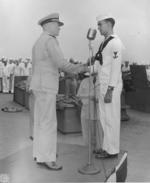 Captain Carl Holden at an award ceremony aboard USS New Jersey, 24 Jul 1943, photo 2 of 2