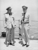 Captain Carl Holden (right) and an unidentified officer aboard USS New Jersey, date unknown