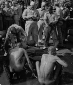 Public humiliation of Japanese prisoners of war aboard USS New Jersey, Dec 1944, photo 4 of 6