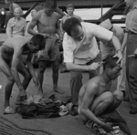 Public humiliation of Japanese prisoners of war aboard USS New Jersey, Dec 1944, photo 3 of 6