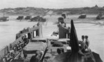 USS LCT-535 unloading vehicles onto a Normandie beach, France, 1944
