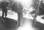 Bill Hale of US 5332nd Brigade (Provisional) issuing pay, Nalong, Kachin, Burma, 24 Dec 1944