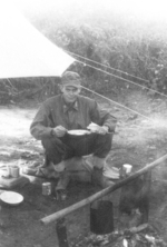 Major Gus Edwards of US 5332nd Brigade (Provisional) eating a field in the field, Nalong, Kachin, Burma, 24 Dec 1944