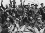 Polish prisoners celebrating, Dachau Concentration Camp, Germany, late Apr or early May 1945