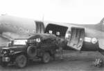 Loading cargo onto a C-47 aircraft, Lashio Airfield, Shan, Burma, Apr 1945; photo taken by personnel of US 5332nd Brigade (Provisional)
