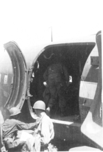 Personnel of US 5332nd Brigade (Provisional) boarding a C-47 aircraft, Lashio Airfield, Shan, Burma, Apr 1945