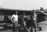Sergeant Bev Cole, Lieutenant Sittner, Corporal Pierce of US 5332nd Brigade (Provisional) at Landis air strip with a L-5 aircraft, Kachin, Burma, Dec 1944
