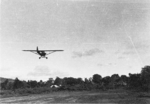 Lieutenant Sittner of US 5332nd Brigade (Provisional) taking off with a L-5 liaison aircraft, Landis airfield, Kachin, Burma, Dec 1944