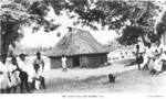 Postcard featuring a village along Cuva creek, Fiji, 1940s