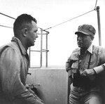Commander Air Group 80, Commander Albert O. Vorse, discussing the results of the 6 Nov 1944 raid on Manila with Rear Admiral Arthur W. Radford, right, aboard the USS Ticonderoga.