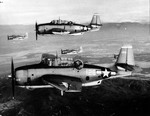 Four TBM Avengers of Torpedo Squadron 4 flying from the USS Essex on their way to strike targets along the coast of French Indochina (now Vietnam), 12 Jan 1945.