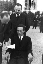 Joseph Goebbels in the garden of the Carlton Hotel in Geneva, Switzerland during the League of Nations conference, Sep 1933. His glare is said to be upon learning the photographer was Jewish.