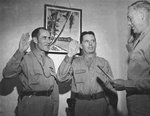 Brigadier General Clarence Tinker and Colonel Willis Hale being sworn into their new, next higher ranks by Colonel Cheney Bertholf, Adjutant General of the 7th Air Force, Hickam Field, 21 Jan 1942.