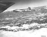 B-17 Fortresses of the 301st Bomb Group over the Italian Alps on their way to the rail yards in Vienna, Austria, 12 Mar 1945. Note the B-17 in the center with its ball turret replaced with the H2X ground scanning radar.