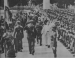 Wang Jingwei inspecting Chinese collaborationist troops, Guangzhou, Guangdong Province, China, 15 Jun 1942; note group of Japanese officers in background