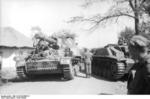 SdKfz 165 and Sturmgeschütz III vehicles in a Soviet village, fall 1943