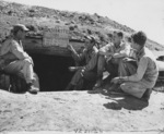 2nd Lieutenant Donald Rusling, Captain Donald Garrett, 2nd Lieutenant Lester Bartils, and 2nd Lieutenant Glenn Hunter at a bomb shelter, Yontan Airfield, Okinawa, Japan, 1945