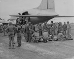 Wounded US Marines being loaded onto an aircraft for evacuation, Yontan Airfield, Okinawa, Japan, 1945; note female USN nurse Ensign Jane Kendeigh