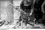 German solder inspecting a captured St. Étienne Mle 1907 machine gun, France, May 1940