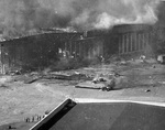 Seaplane hanger ablaze after being bombed by Japanese aircraft, Ford Island, Pearl Harbor, US Territory of Hawaii, 7 Dec 1941, photo 2 of 2