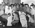 Capt Dixie Kiefer (left) and executive officer Cdr Willian Burch, both badly injured in an air attack four days earlier, being prepared for transfer from Ticonderoga to the hospital ship Samaritan at Ulithi, 25 Jan 1945