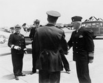Commandant of the First Naval District Rear Admiral Felix Gygax and Commander, Naval Air Bases, First Naval District Commodore Dixie Kiefer arriving at Otis Field, Cape Cod, Massachusetts, United States 28 May 1945.